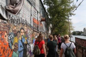 Students looking at street art